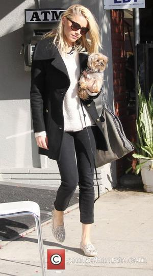 Amber Heard leaves a nail salon in Hollywood carrying her pet Yorkshire terrier dog named Pistol Los Angeles, California -...