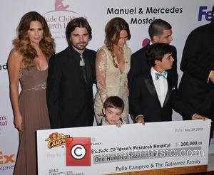 Daisy Fuentes and Juanes