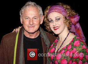 Victor Garber and Katie Finneran (in costume)  Photo op with the cast of the Broadway musical 'Annie' at the...