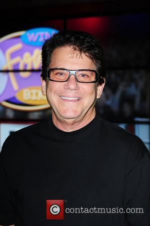 "Anson Williams known as Warren ""Potsie"" Weber from TV show 'Happy Days' at a 'meet and greet' and signs autograph..."
