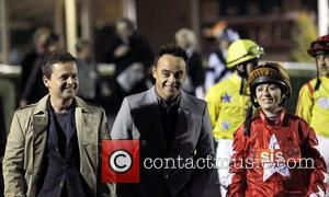Declan Donnelly aka Dec and Anthony McPartlin aka Ant talking to Jockey Kirsty Milzcarek at Kempton racecourse Surrey, England -...