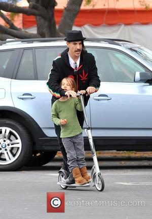 Anthony Kiedis of The Red Hot Chilli Peppers takes a ride on a scooter with his son, Everly Bear Kiedis...