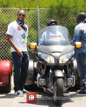 Didier Drogba and Ashley Cole Professional football players from the English Premier League host an event at Eaglerider Motorcycles in...