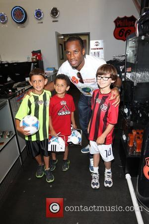 Didier Drogba Professional football players from the English Premier League host an event at Eaglerider Motorcycles in support of 'armsaroundthechild.org'...