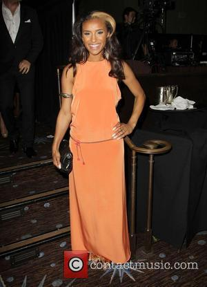 Melody Thornton and Beverly Hilton Hotel