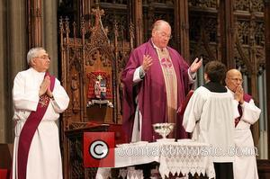 Newly elected Cardinal Timothy Dolan leads an Ash Wednesday ceremony St. Patrick's Cathedral New York City, USA - 22.02.12