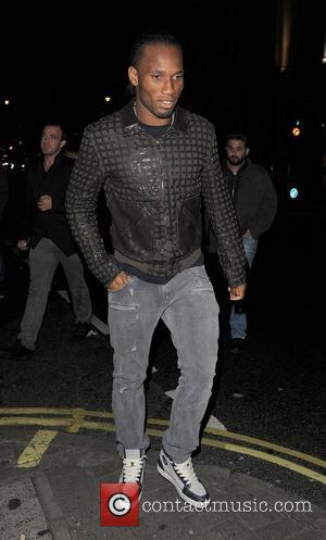 Chelsea FC footballer Didier Drogba, leaving Aura nightclub at 3.30am with other members of the team, following their 4-1 win...