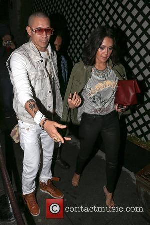 Taboo aka Jaime Luis Gomez of The Black Eyed Peas and wife Jaymie Dizon arrive at AV Nightclub in Hollywood...