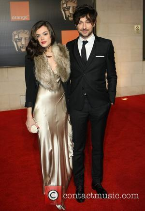 Alex Zane and guest Orange British Academy Film Awards (BAFTAs) afterparty held at The Grosvenor House Hotel - Outside Arrivals...