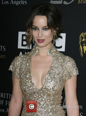 Berenice Marlohe and Beverly Hilton Hotel