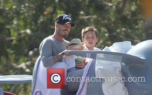 David Beckham, Harper Beckham and Brooklyn Beckham ,  Beckham family on a day out to Disneyland. Los Angeles, California...