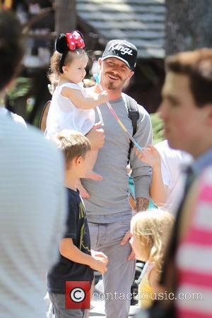 David Beckham, Harper Beckham,  Beckham family on a day out to Disneyland. Los Angeles, California - 06.06.12
