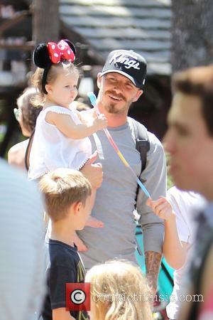 David Beckham, Harper Beckham ,  Beckham family on a day out to Disneyland. Los Angeles, California - 06.06.12