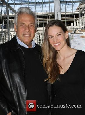Hawk Koch and Hilary Swank