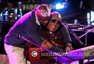 Wyclef Jean and Stevie Wonder