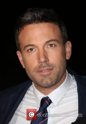 Ben Affleck Lights Up 'Argo' Premiere
