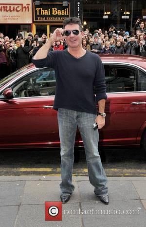 Simon Cowell Offers Private Plane For Tv Crew Dad