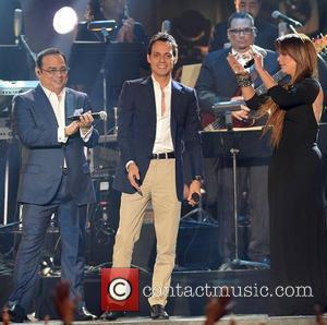 Marc Anthony and Olga Tanon