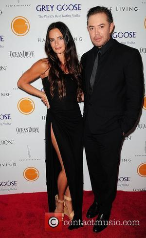 Gabrielle Anwar and Shareef Malnik attend the Black's Annual Gala 2012 - Arrivals at Fontainebleau Miami Beach. Miami Beach, Florida...