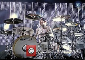 Travis Barker of Blink 182 performing live at the Liverpool Echo Arena. Liverpool, England - 12.07.12