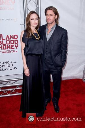 Angelina Jolie and Brad Pitt  Premiere of 'In the Land of Blood and Honey' at the School of Visual...
