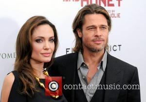 Angelina Jolie and Brad Pitt at the premiere of 'In the Land of Blood and Honey' at the School of...