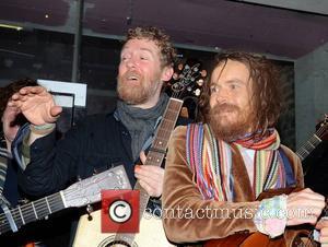 Damien Rice, Glen Hansard Bono and Glen Hansard join buskers singing for charity at the entrance to St Stephen's Park...