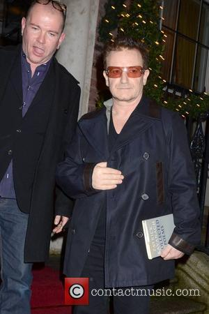 Sinead O'connor & Glen Hansard Join Bono For Christmas Eve Busk