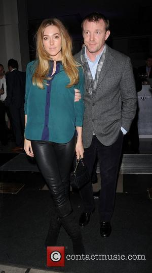 Jacqui Ainsley and Guy Ritchie at the H.R. Owen and Boujis Mayfair Party to launch the Bentley Continental GT V8...