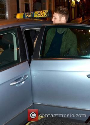Brian McFadden and Vogue Williams hail down a taxi as they leave Dublin's Wilde bar after watching a Burlesque show....