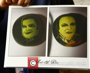 A man shows off a his portfolios of melon art, featuring the faces of Ant and Dec, at the auditions...