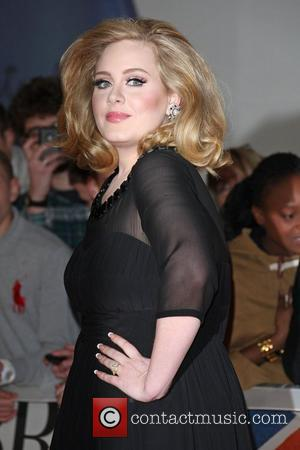 Adele Steps Out With New Baby