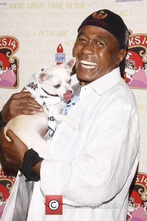 Ben Vereen holds Chachi, a dog up for adoption Broadway Barks: The 14th Annual Dog and Cat Adopt-a-thon held in...