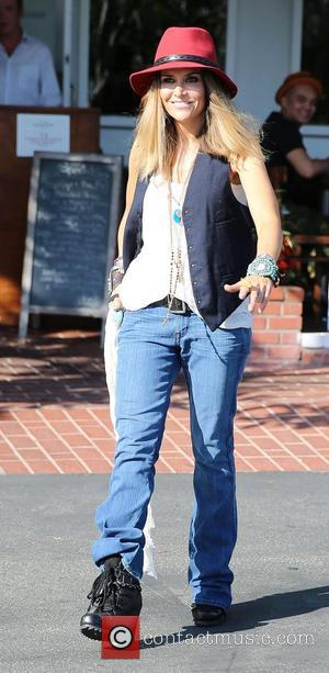 Brooke Mueller heads for Fred Segal in West Hollywood wearing a waistcoat, jeans and red felt hat Los Angeles, California...
