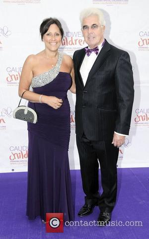 Max Clifford and guest,  atThe Diamond Butterfly Ball in aid Of Caudwell Children at Battersea Evolution. London, England -...