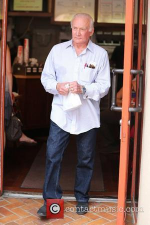 American astronaut Buzz Aldrin carries a take out bag from Judy's Deli in Beverly Hills Los Angeles, California - 16.08.12