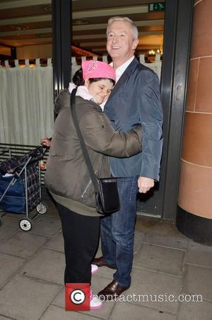 Louis Walsh and celebrity hugger Tanya Macintosh  X Factor judges outside C London restaurant, after earlier appearing on the...