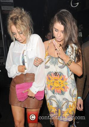 Sacha Parkinson and Brooke Vincent both appear rather camera shy, as they leave Cafe de Paris nightclub at 3am. London,...