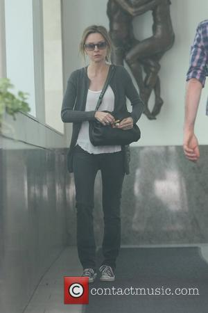 Calista Flockhart shopping in Beverly Hills wearing Converse sneakers Los Angeles, California - 29.11.11
