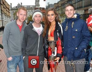Rozanna Purcell posing with fans 'Celebrity Bainisteoir' finalists outside the Today FM studio in Dublin to announce their rival GAA...