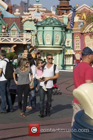 Cam Gigandet spends the day at Disneyland with his girlfriend Dominique Geisendorff and their daughter Everleigh Anaheim, California - 04.05.12