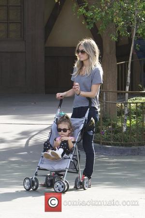Dominique Geisendorff Cam Gigandet spends the day at Disneyland with his girlfriend Dominique Geisendorff and their daughter Everleigh Anaheim, California...