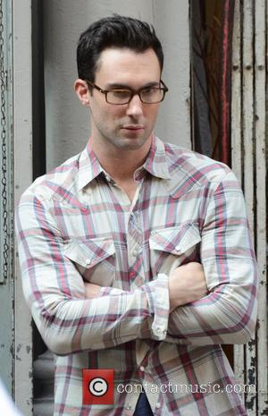 Adam Levine filming on the set of his new movie 'Can A Song Save Your Life?' in Manhattan. Produced by...