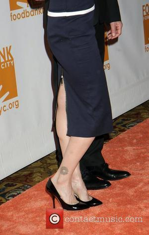 Kyra Sedgwick, Tattoo and Wall Street