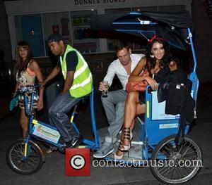 Layla Flaherty, Carol Anthony, Greg Lake in a pedicab outside Harry's Bar at the Stephens Green venue Dublin, Ireland -...