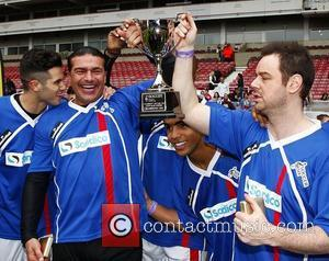 Tamer Hassan and Danny Dyer holding up the trophy after winning Celebrity Soccer Six match, held at West Ham Football...