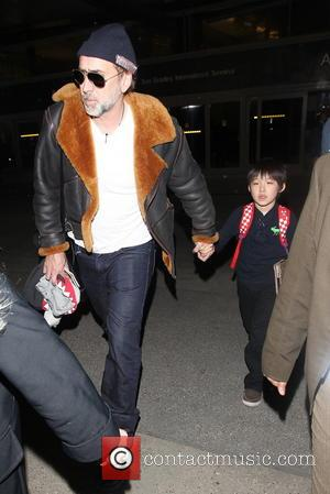 Nicolas Cage; Kal-El Cage Celebrities arrive at Los Angeles International Airport (LAX)  Featuring: Nicolas Cage, Kal-El Cage Where: Los...