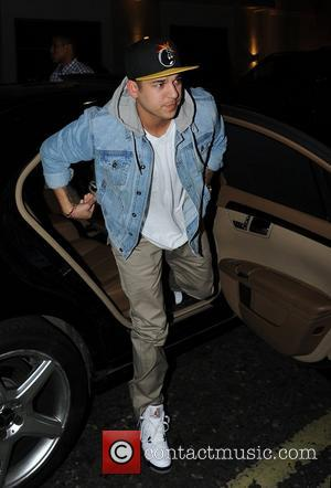 Rob Kardashian arrives at Whiskey Mist. Rumored girlfriend Rita Ora arrived in a separate car possibly to avoid being photographed...