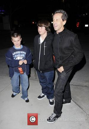 Brian Grazer and his sons arriving at the Staples Center to watch Jay-Z and Kanye West in concert Los Angeles,...