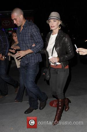 Jaime Pressly arriving at the Staples Center to watch Jay-Z and Kanye West in concert Los Angeles, California - 11.12.11